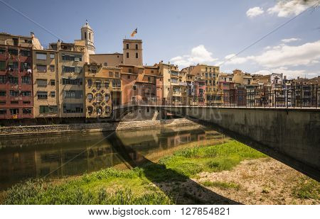 Colorful houses reflected on the river in Girona, Spain ** Note: Soft Focus at 100%, best at smaller sizes