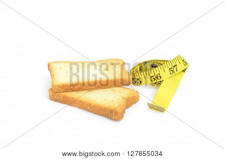 Rusk and measure tape. Weight loss concept.