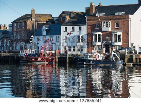 Weymouth, UK - April,17, 2016. Fishing boats moored in Weymouth harbour. Weymouth is a fishing harbour and popular holiday resort.
