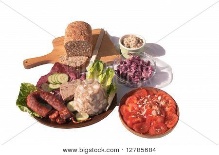 Various Salads And Meats With Bread For A Picnic