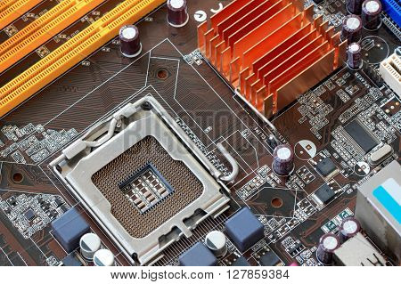 Focus CPU socket on motherboard of computer for the design background technology.