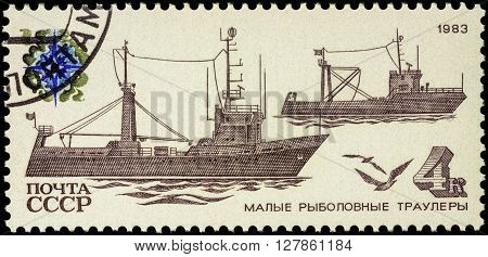 MOSCOW RUSSIA - APRIL 26 2016: A stamp printed in USSR (Russia) shows coastal trawlers series