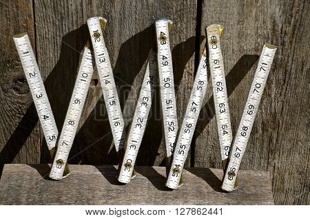 Old shop wooden folding ruler measuring in inches.