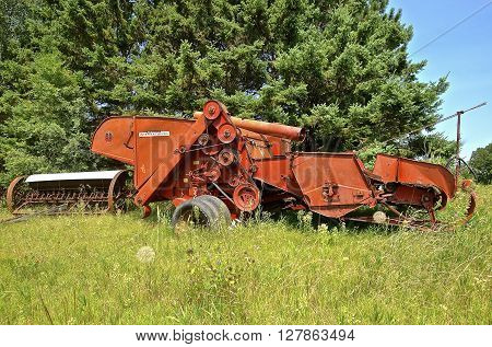 BLACKDUCK, MINNESOTA,, August 13, 2015: A Farmall 80 combine was a model name and later a brand name for machinery manufactured by the American company International Harvester. Co. (IH)