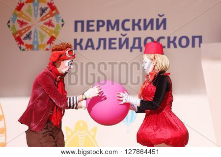 PERM RUSSIA - JUNE 5 2015: Clowns hold ball on open air stage at Perm Kaleidoscope Festival