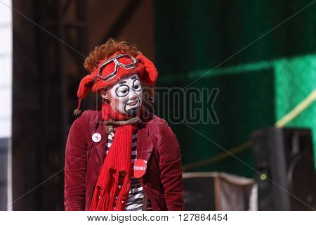 PERM RUSSIA - JUNE 5 2015: Clown in hat performs on open air stage at Perm Kaleidoscope Festival