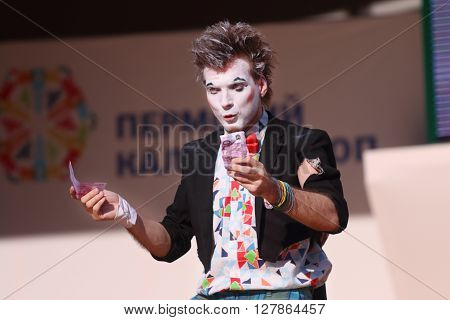 PERM RUSSIA - JUNE 5 2015: Clown holds money on open air stage at Perm Kaleidoscope Festival