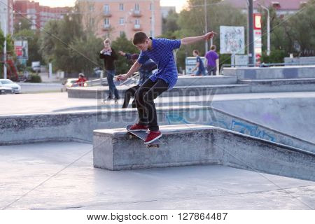 PERM RUSSIA - JUNE 7 2015: Skateboarder jumps. New big playground for skateboarders opened in Perm
