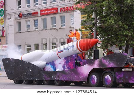 PERM RUSSIA - JUN 12 2015: Model of rocket at street procession during day of Russia