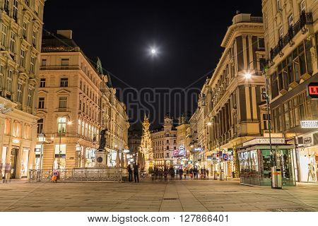VIENNA AUSTRIA - 22ND APRIL 2016: A view along the Graben in Vienna at night. The outside of buildings and the blur of people can be seen.
