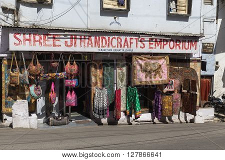 UDAIPUR INDIA - 20TH MARCH 2016: The outside of a shop in Udaipur selling bags rugs and other merchandise