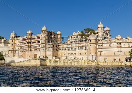 UDAIPUR INDIA - 20TH MARCH 2016: Part of the city palace in Udaipur during the day from the lake.