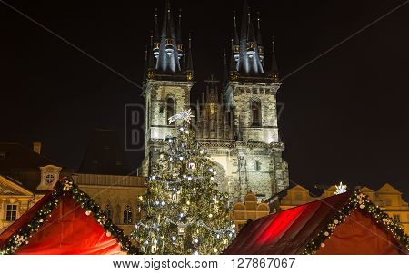 PRAGUE CZECH REPUBLIC - 6TH DECEMBER 2015: Church of Our Lady before Tyn and Christmas Tree at Old Town Square in Prague at night.