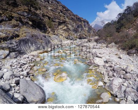 Mountain small river with white cold clear water, Sagarmatha National Park, Nepal