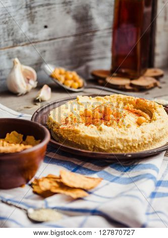 Hummus Of Chickpeas, Tahini Paste And With Paprika In A Clay Plate