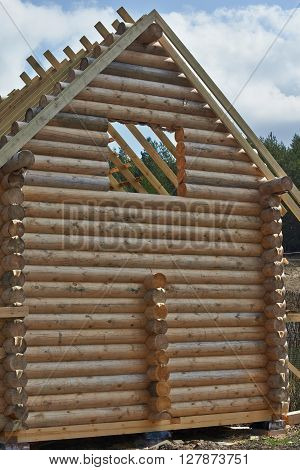 The design and details of a log home under construction.