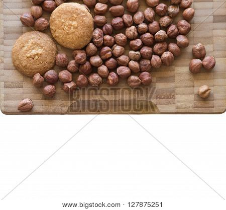 Homemade delicious cookies biscotti with hazelnuts on the table. horizontal top view from above. Bamboo and wooden board background with free text space