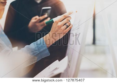 Business meeting office.Photo woman writing statistics info chart board.Photo account managers crew working with new startup project.Idea presentation, analyze marketing plans.Blurred, horizontal