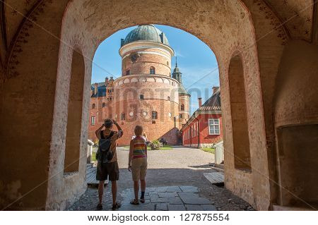 MARIEFRED, SWEDEN - AUGUST 4:  Tourists visit Gripsholm Castle on August 4, 2011 in Mariefred. This is a royal castle that now is a museum and a popular tourist attraction.