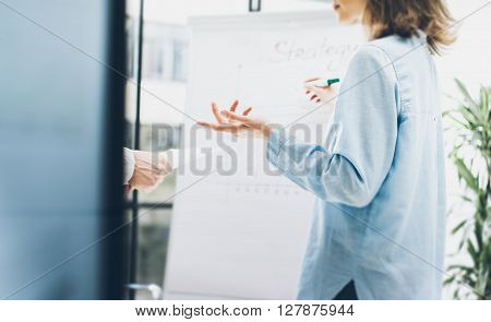 Business process office.Photo woman writing startegy idea chart board.Photo account manager crew working with new startup project.Idea presentation, brainstorming. Blurred, film effect.