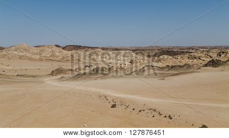 Moonscape of Namibia. Desolate rocky area. Sandy area.