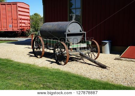 PLAINFIELD, ILLINOIS / UNITED STATES - SEPTEMBER 20, 2015: An antique oil cart is on display outside the old Plainfield, Illinois Depot, which is now a museum operated by the Plainfield Historic Preservation Commission.