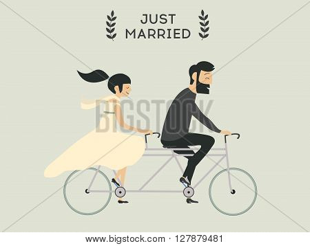 Just married wedding couple riding bicycle. Wedding couple on bicycle