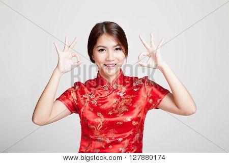 Asian Girl In Chinese Cheongsam Dress Show Ok Sign