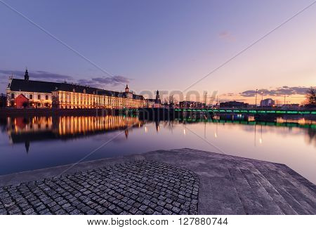 University bridge and Wroclaw university in the evening. Poland. Europe.