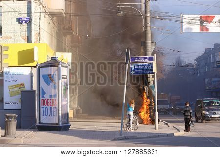 PERM RUSSIA - MAY 1 2015: Fires electric box on street cars and people