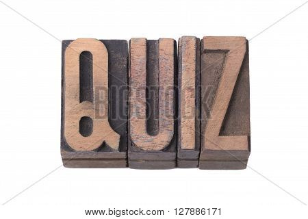 quiz word made from tilted wooden letterpress type isolated on white
