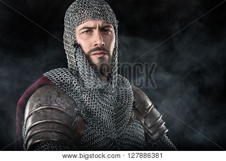 Medieval Warrior With Chain Mail Armour And Red Cloak