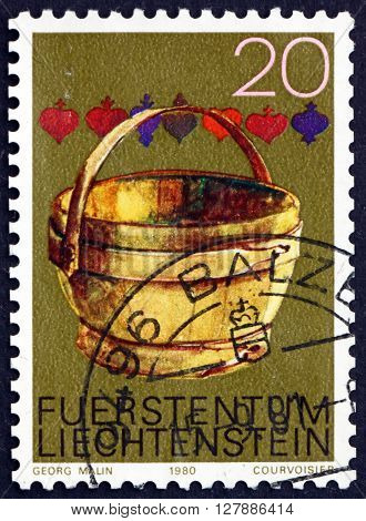 LIECHTENSTEIN - CIRCA 1980: a stamp printed in Liechtenstein shows Milking Pail Old Alpine Farm Tools circa 1980