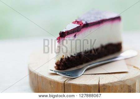 Slice Of Delicious Raspberry Cheesecake On Wooden Plate