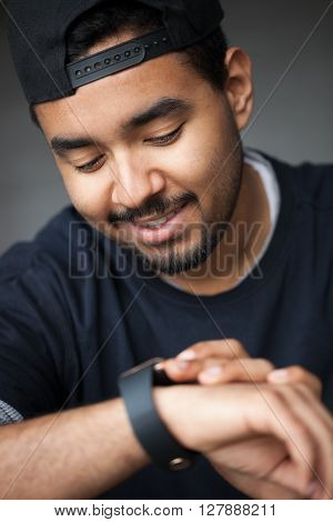 Young Black Rapper Guy Using Smart Wrist Watch