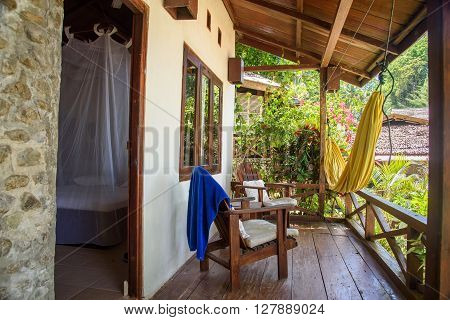 Kadidiri island Indonesia - Dec 15 2015: Bungalow Veranda in Black Marlin Dive Resort. Togean Islands or Togian Islands in the Gulf of Tomini. Central Sulawesi.