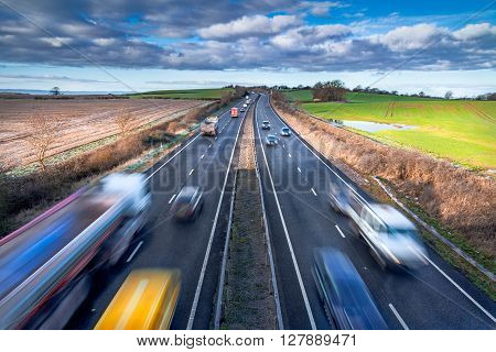 Fast Moving Vehicles on Busy Motorway, Morning Light