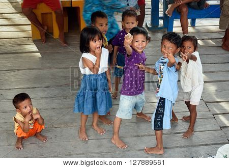 Indonesian Children On The Pier In Tobil Village Togean Islands