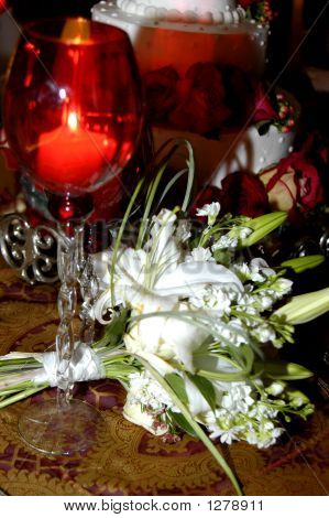 Candle Glow And White Bouquet
