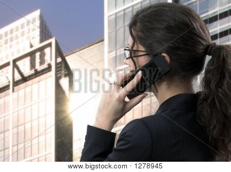 Young Businesswoman Talks On Mobile