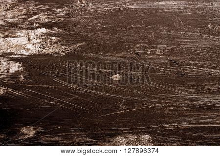 Brown Grunge background with paint brush marks and scratches.