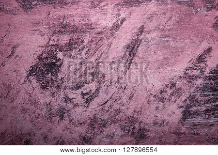 Pink Grunge background with paint brush marks and scratches.