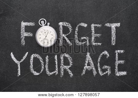 forget your age phrase handwritten on chalkboard with vintage precise stopwatch used instead of O