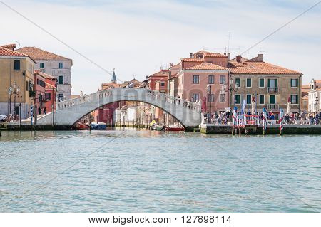 Chioggia Italy - April 30 2016: The Vico's bridge in Chioggia Italy seen from the Venetian lagoon. The famous bridge the destination of many tourists was built in 1685.