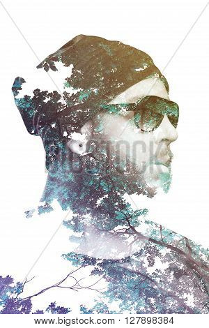 Double exposure portrait of male combined with branches and trees. Gradient effect applied. Vintage look.