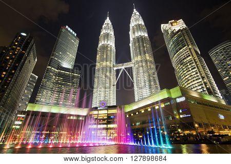 Kuala Lumpur, Malaysia - May 6, 2014: View of famous Petronas Towers lit up at night in Kuala Lumpur, Malaysia.