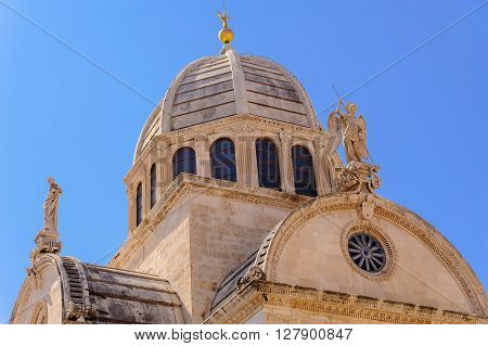 Archangel Michael's statue and dome of St. James cathedral