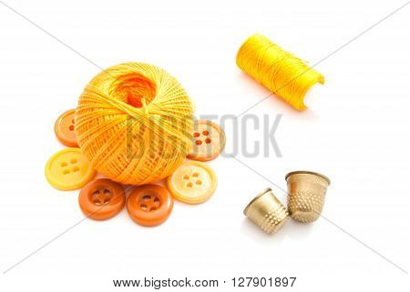 Yellow Plastic Buttons, Thimbles And Thread