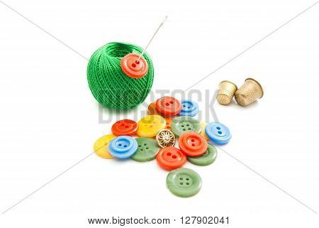 Needle, Colored Buttons, Thimbles And Green Thread