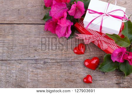 Gift boxes pink Bougainvillea three hearts on wooden board